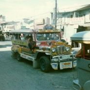 Jeepney on Fields Avenue. The flat roof makes for great Jeepney surfing.
